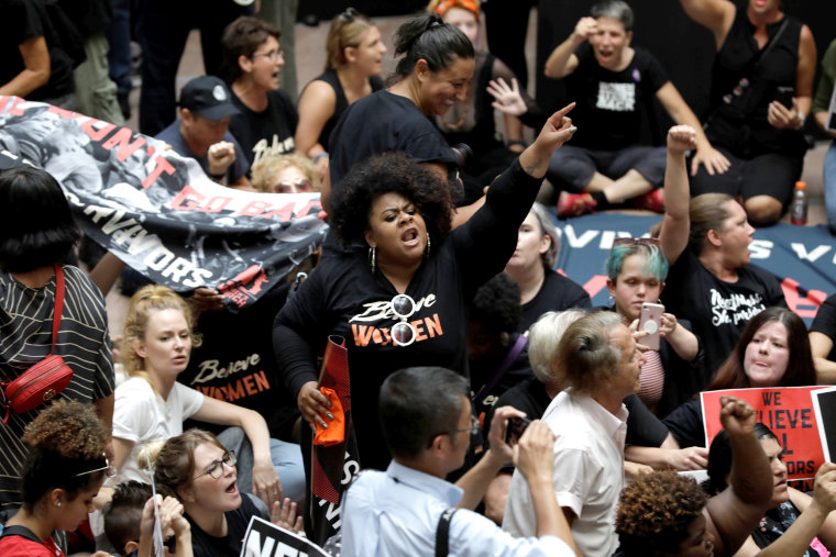 Image: Activists rally inside the Senate Hart Office Building during a protest in opposition to U.S. Supreme Court nominee Kavanaugh on Capitol Hill in Washington