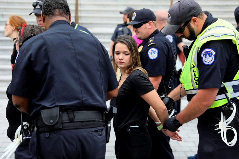 Image: U.S. Capitol Police arrest protesters in the hours ahead of a scheduled U.S. Senate vote on the confirmation of Supreme Court nominee Kavanaugh in Washington