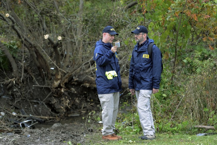Members of the National Transportation Safety Board work at the scene of yesterday's fatal crash, in Schoharie