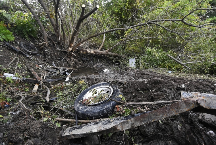 Debris is seen scattered Sunday, Oct. 7, 2018, at the site of yesterday's fatal crash Schoharie, New York.