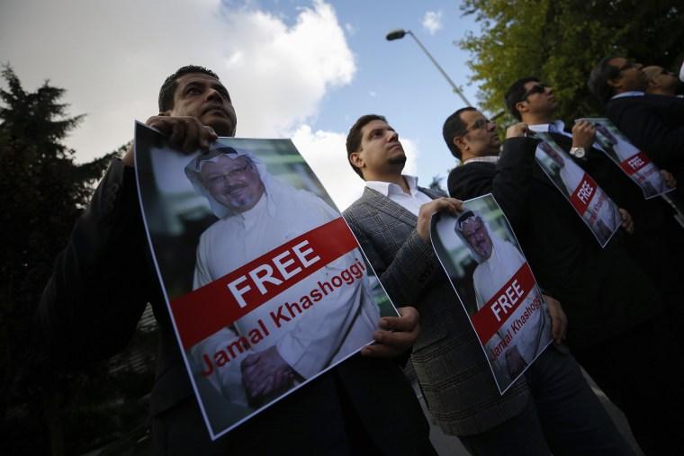 People gather in support of missing Saudi writer Jamal Khashoggi near the Saudi Arabia consulate in Istanbul on Oct. 5, 2018.