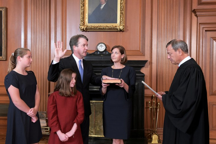 Image: Judge Brett Kavanaugh is sworn in as an Associate Justice of the U.S. Supreme Court by Chief Justice John Roberts at the Supreme Court in Washington