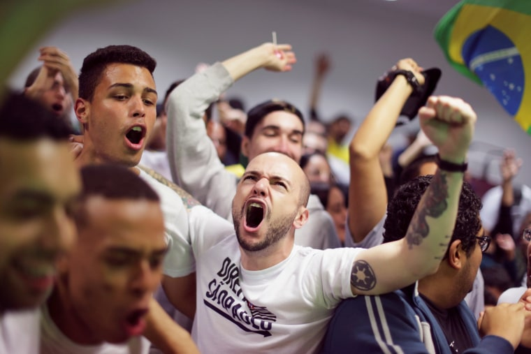 Image: Supporters of Jair Bolsonaro, far-right lawmaker and presidential candidate of the Social Liberal Party (PSL), react, in Sao Paulo