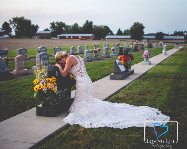 Bride-to-be mourns at fiance's grave in wedding gown