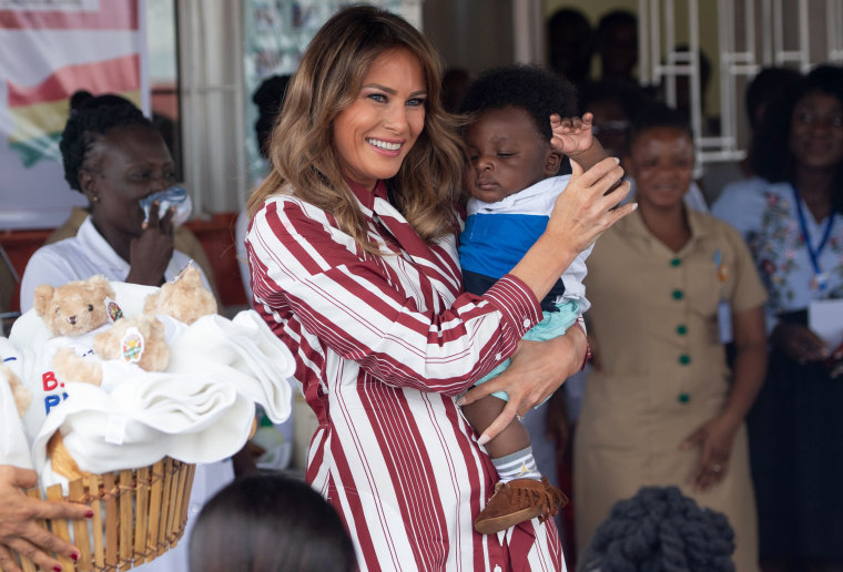 Image: First lady Melania Trump holds a baby in Accra, Ghana