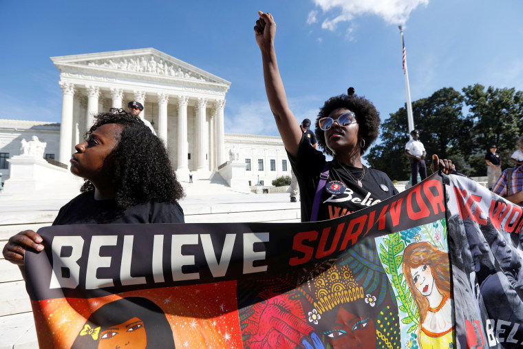 Image: Activists hold a protest march and rally in opposition to U.S. Supreme Court nominee Brett Kavanaugh in Washington