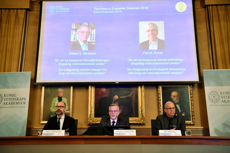 Image: Per Stromberg, Goran K. Hansson and Per Krusell annonce the laureates of the Nobel Prize in Economics during a press conference at the The Royal Swedish Academy of Sciences in Stockholm