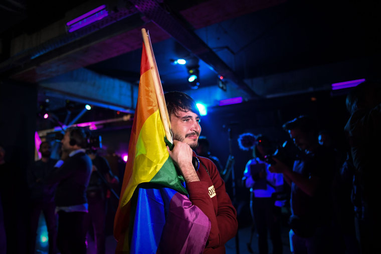 Image: A member of the LGBT community in a club as community members wait for the results of a referendum