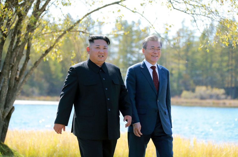 Image: North Korea's leader Kim Jong Un (L) and South Korean President Moon Jae-in (R) walking together during a visit to Samjiyon guesthouse
