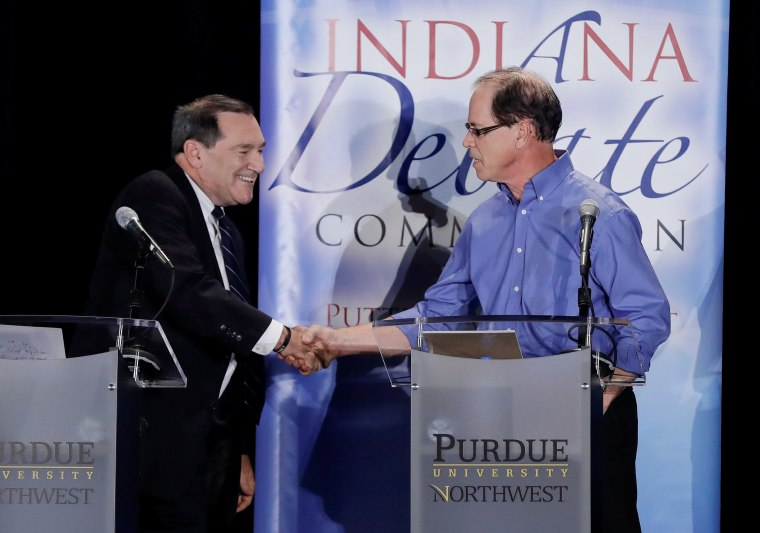 Image: Democratic US Senator Joe Donnelly Former Republican Republican Mike Brown shaking hands after a debate in the US Senate in Westville, Indiana