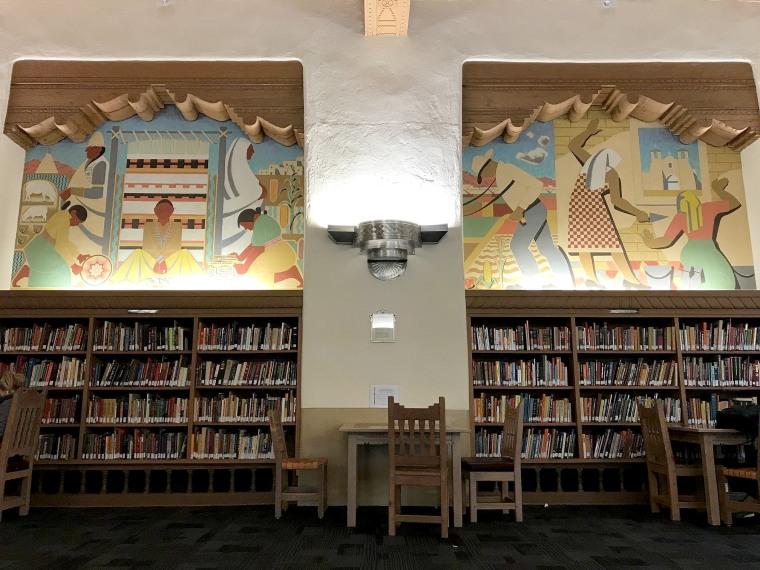 Image: Two Great Depression-era murals that depict Native Americans and Hispanics are seen on the walls of the west wing at the University of New Mexico's Zimmerman Library