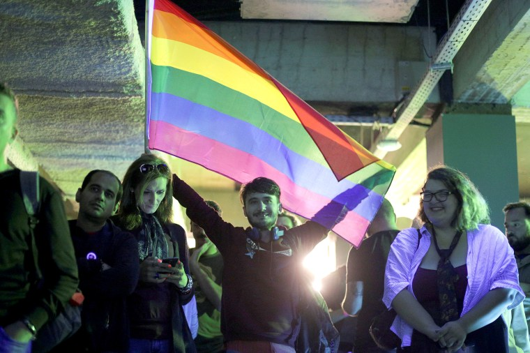 "Image: LGBT activists react during an event organised by the LGBT rights group ""Mozaiq"" in downtown Bucharest,"