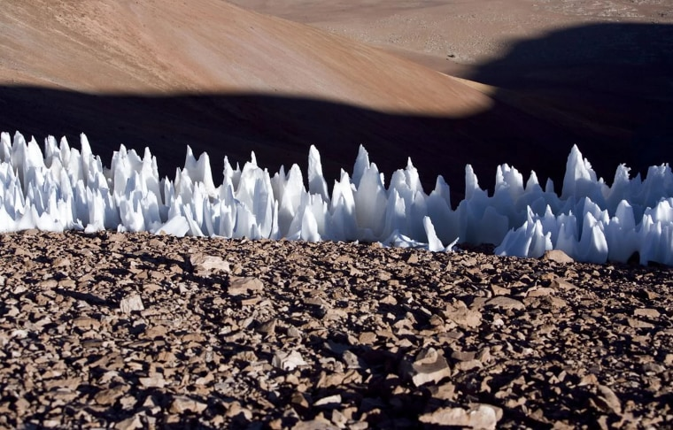 Blade-like ice towers called penitentes occur on Earth in some high, dry and cold tropical regions -- especially the Chilean Andes, as seen here.
