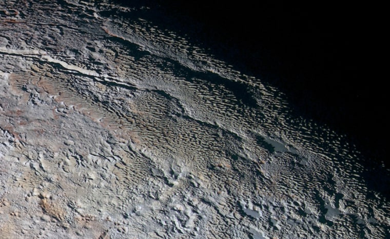 """The """"bladed terrain"""" on Pluto, seen here by NASA's New Horizons spacecraft during the probe's 2015 flyby of the dwarf planet, is consistent with ice-tower features called penitentes."""