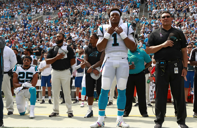 Carolina Panthers' Eric Reid (25) kneels