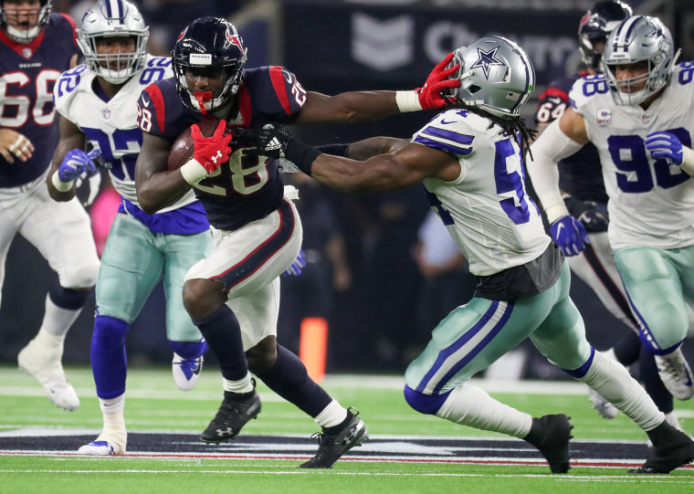Houston Texans running back Alfred Blue (28) stiff arms Dallas Cowboys linebacker Jaylon Smith (54) during the first half at NRG Stadium