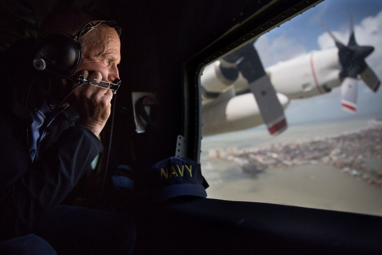 Gov. Rick Scott looks out the window of a C-130 as he looks at damage to the Florida Keys during the aftermath of Hurricane Irma