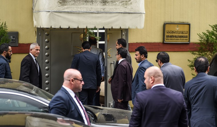 Image: Saudi officials arrive at Saudi Arabia's consulate in Istanbul on Tuesday as demonstrators gather to protest the Khashoggi's disappearance