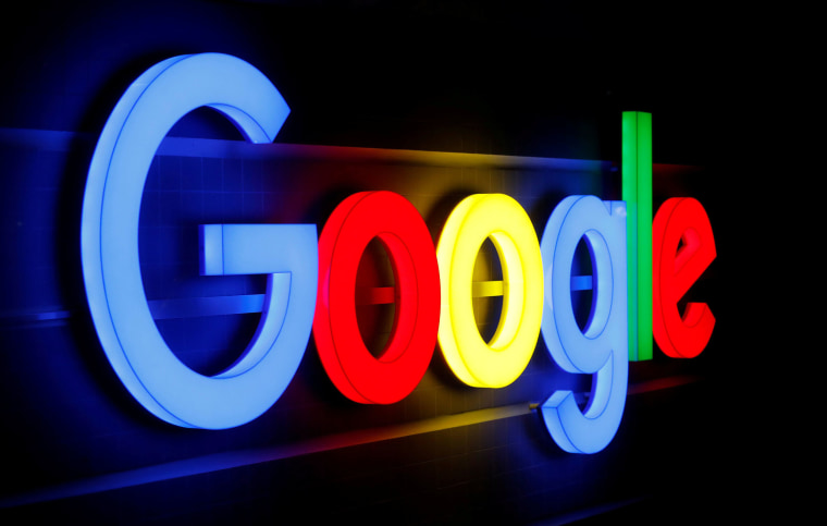 An illuminated Google logo is seen in Zurich