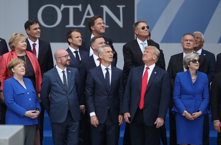 Image: President Donald Trump stands with the leaders of other NATO nations