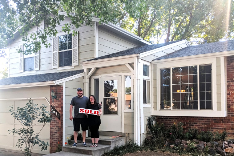Carrie S. Nicholson and her husband Ryan the day they closed on their new home.