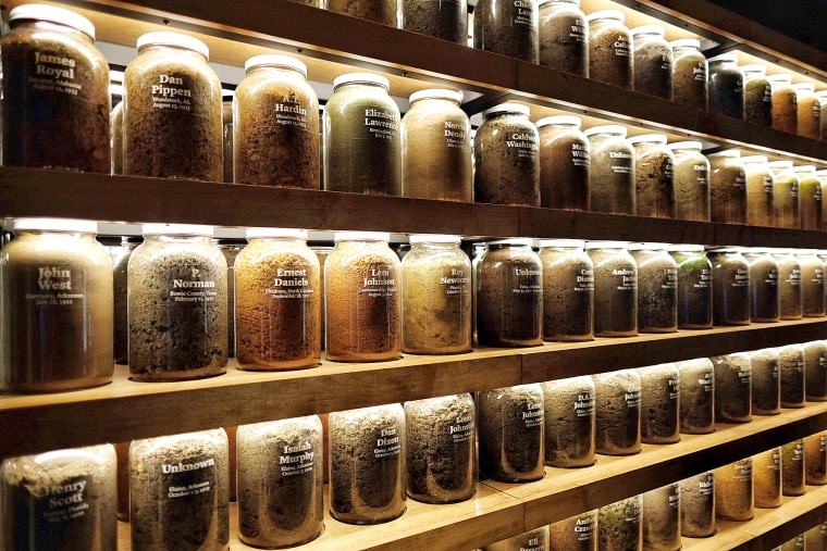 Jars of soil from over 280 lynching sites around the country sit on shelves in the Equal Justice Initiative office on Oct 9, 2018.