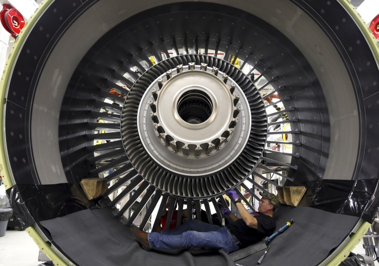 An employee assembles a GE90 engine at the GE Aviation Peebles Test Operations Facility in Peebles, Ohio