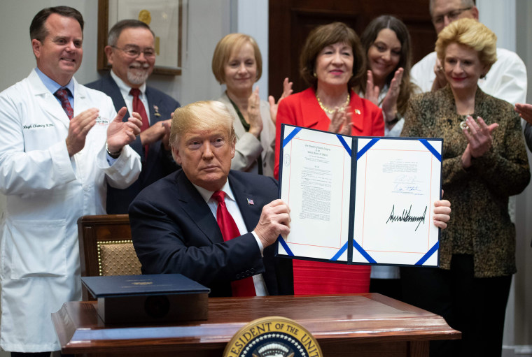 President Donald Trump signs bills intended to lower prescription drug prices during a ceremony at the White House on Wednesday, Oct. 10, 2018.
