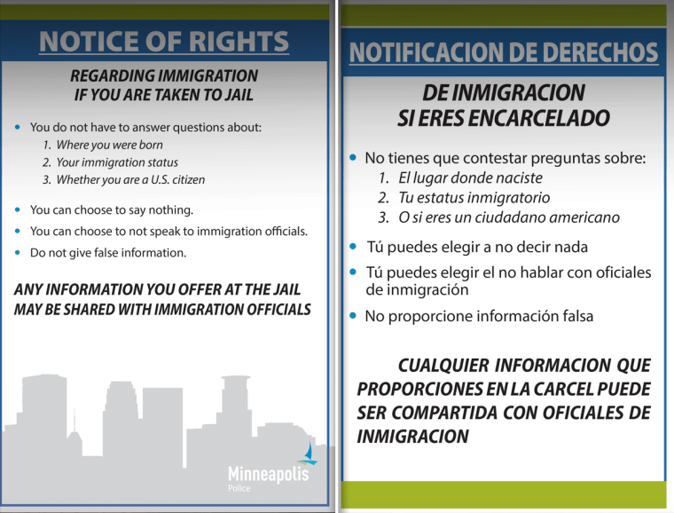 Minneapolis immigrants rights placards in English and Spanish