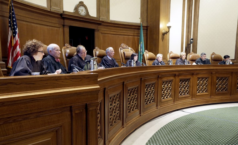 Justices on the Washington state Supreme Court listen during a hearing in Olympia, Washington on Sept. 7, 2016.