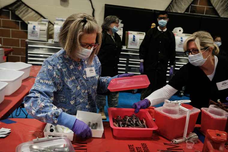Volunteers sterilize medical supplies at a Remote Area Medical (RAM) mobile dental and medical clinic in Milton