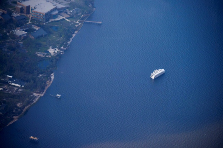A capsized boat is seen during a U.S. Coast Guard aerial assessment of coastal areas affected by Hurricane Michael near Apalachicola