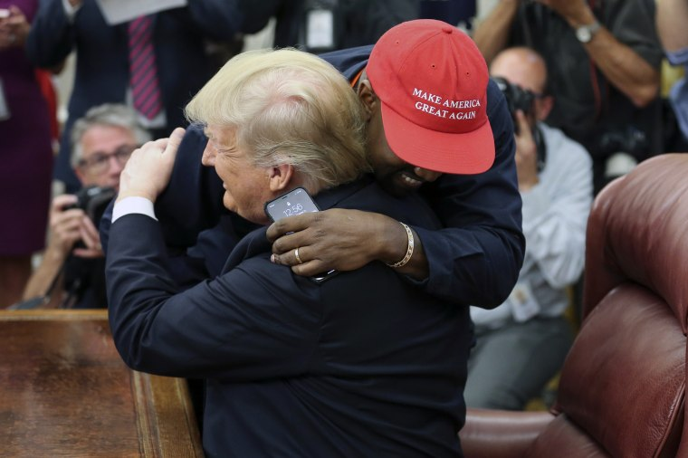 President Donald Trump hugs rapper Kanye West during a meeting in the Oval office on Oct. 11, 2018.