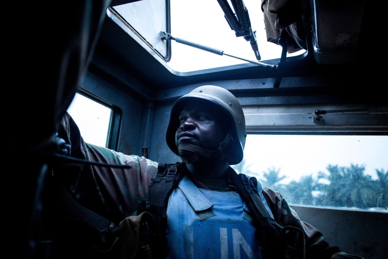 South African soldier from the United Nations Stabilisation Mission in the Democratic Republic of the Congo (MONUSCO) sits in the back of an armored personal carrier on Oct. 5, 2018 in Oicha. - The town of Oicha is the site of constant attacks by the Allied Democratic Front (ADF) rebel group. MONUSCO soldiers are sent to help the Armed Forces of the Democratic republic of the Congo(FARDC) in the fight against ADF.