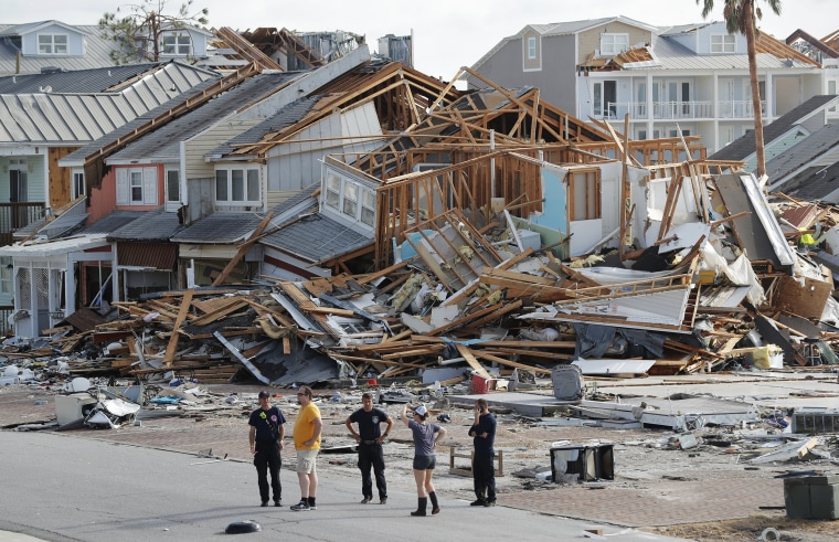 Rescue personnel perform a search in the aftermath of Hurricane Michael in Mexico Beach