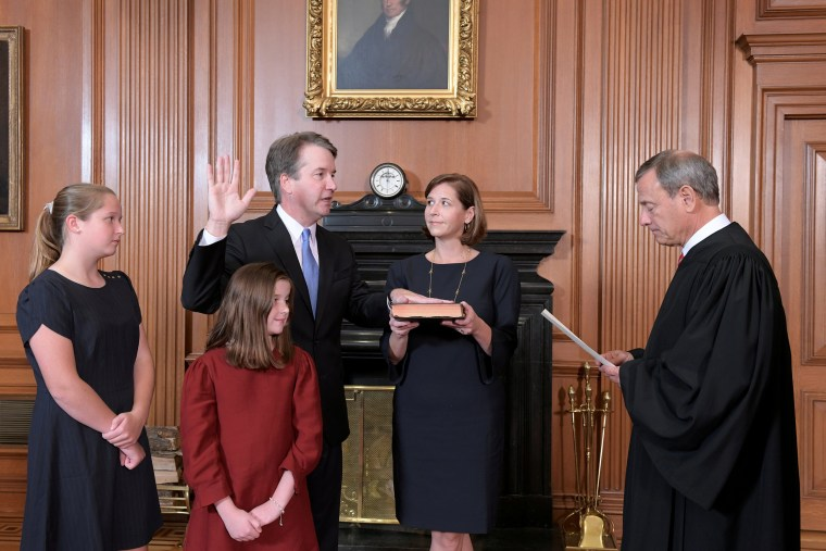 udge Brett Kavanaugh is sworn in as an Associate Justice of the U.S. Supreme Court by Chief Justice John Roberts at the Supreme Court in Washington