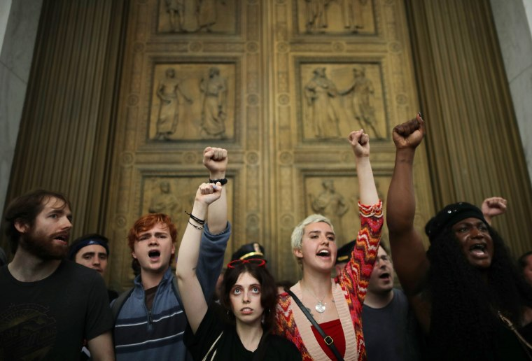 After overrunning police barricades, protesters chant as they block the doors to the U.S. Supreme Court while demonstrating against the confirmation of Associate Justice Brett Kavanaugh on Oct. 6, 2018. The protesters marched up to the doors of the court as Kavanaugh was inside taking his oath.
