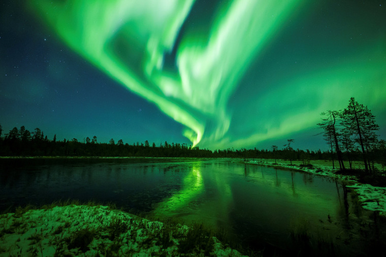 The Aurora Borealis (Northern Lights) is seen over the sky near Rovaniemi in Lapland, Finland, Oct. 7, 2018.
