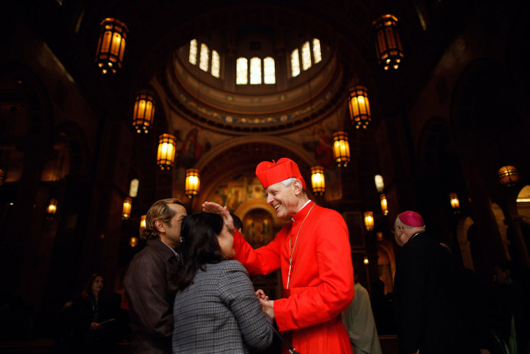 Image: Cardinal Donald Wuerl, Archbishop of Washington, blesses Benilda Tiongco as she enters the Cathedral of St. Matthew in Washington, DC.