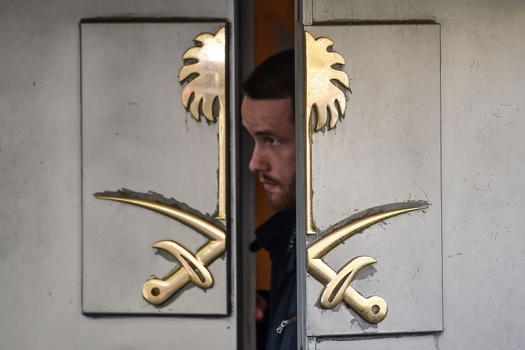 Image: A security guard looks out of the entrance to the Saudi Arabian Consulate in Istanbul.