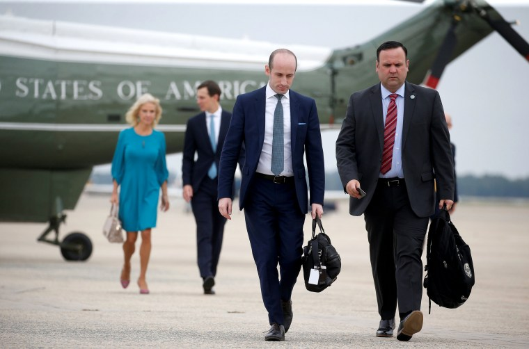 Image: White House staff depart with U.S. President Trump for travel to Florida from Joint Base Andrews