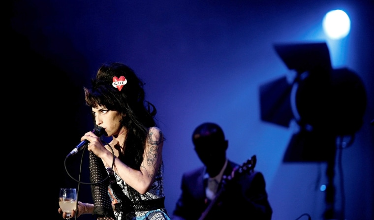 """Image: FILE PHOTO: British singer Winehouse performs during \""""Rock in Rio\"""" music festival in Lisbon"""