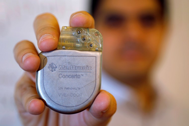 Massachusetts Institute of Technology researcher and graduate student Haitham Al-Hassanieh holds one of the Medtronic heart defibrillators he successfully hacked, at MIT in Cambridge