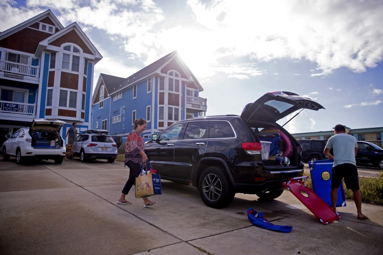 Image: People pack up their cars to prepare to evacuate the Outer Banks area of North Carolina.