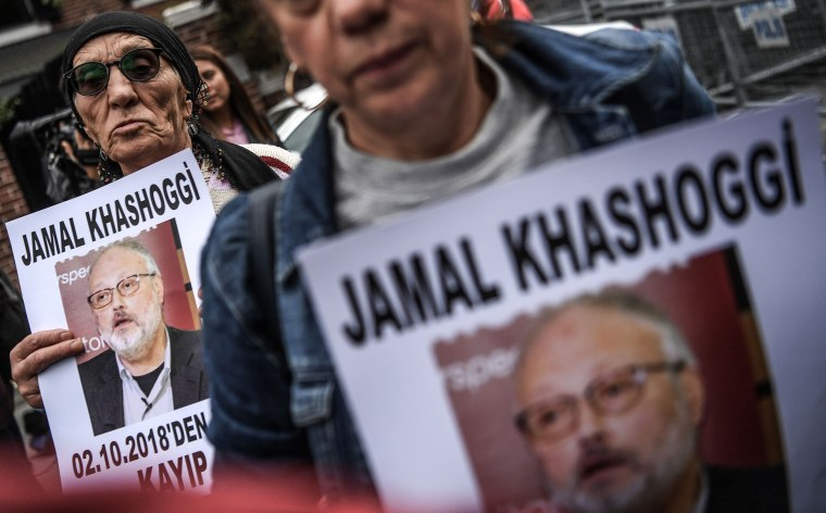 Protesters hold a portrait of missing journalist Jamal Khashoggi during a demonstration in front of the Saudi Arabian consulate in Istanbul on Oct. 9, 2018.