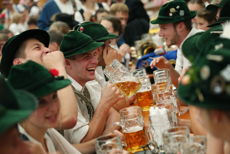 Members of a traditional Bavarian marching band drink beer during Oktoberfest on Sept. 23, 2018 in Munich, Germany.