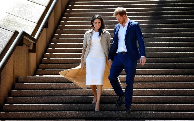 Image: Britain's Prince Harry and his wife Meghan walk down the stairs of the iconic Opera House to meet people on Oct. 16, 2018.