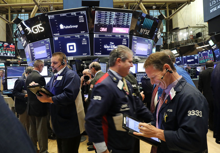 Traders work on the floor of the New York Stock Exchange (NYSE) on Oct. 15, 2018.