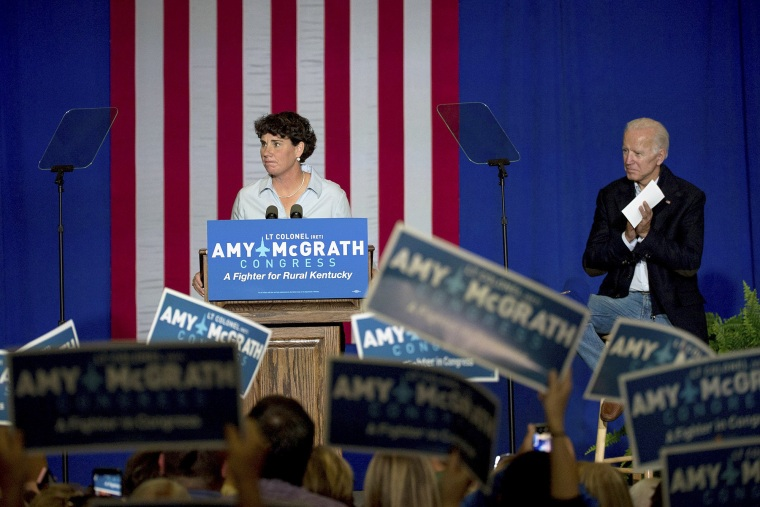 Image: Former Vice President Joe Biden looks on as Democratic congressional candidate Amy McGrath speaks during a campaign event in Owingsville, Kentucky on Oct. 12, 2018.