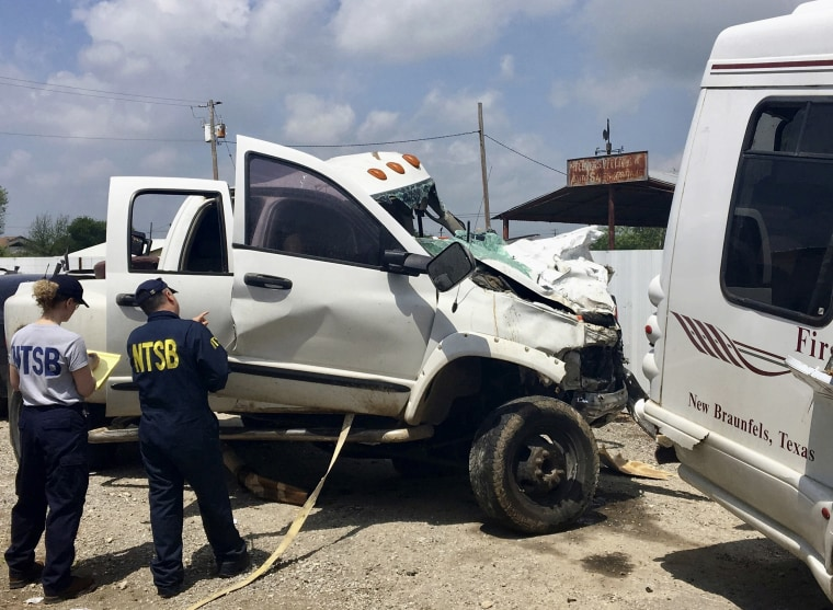 Kristin Poland and David Pereira examine on March 31, 2017, the pickup truck involved in a crash